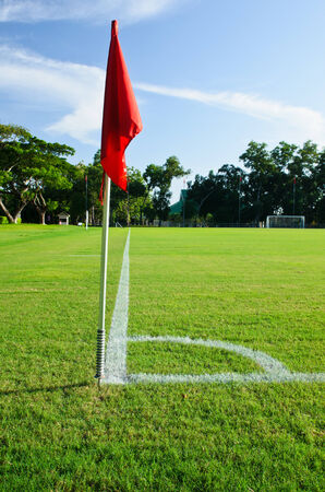 red  flag at soccer field with trees in the background Stock Photo - 28205386