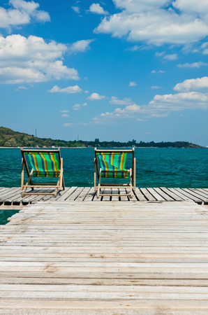 koh samet: wooden chair on the jetty at koh samet in rayong,thailand Stock Photo