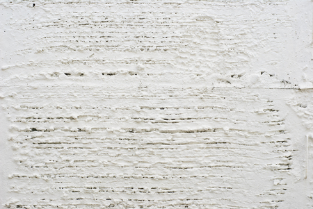corrosion: concrete wall with white painted to prevent corrosion