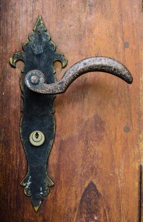 decorative antique door handle of old building photo