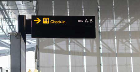 Check in information sign at airport.