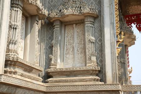 high priest: Thai style molding art on window temple construction Stock Photo