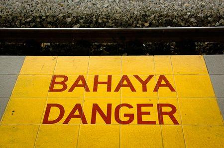 Dirty Danger Sign (Bahaya in Malaysian Language) at a local railway station Stock Photo - 6281876