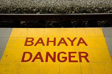 Dirty Danger Sign (Bahaya in Malaysian Language) at a local railway station Stock Photo - 6281876