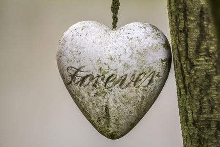 Een hart van steen met de tekst Stockfoto