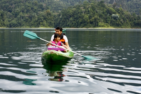 Family , Dad , Mum Daugther, son are Enjoy with Swimming  in Lake at Holiday
