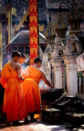back and forth: LAMPANG PROVICE, BANGKOK, THAILAND , 2009 - The Mong and Novice Pray and Walk back and forth in Buddhist holy day. LAMPANG LUANG important in North of Thailand. Editorial