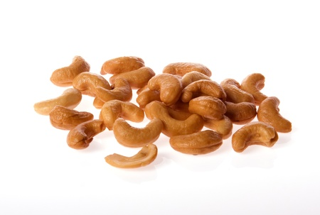 nosh: The Cashew Nut lay on Thw White Background,, fill with Top Lighting and Under Lighting