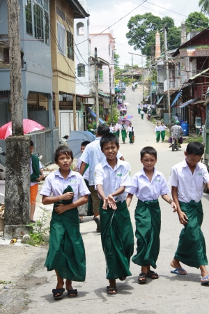 talcum: Student wear sarong go to school.Lifestyle of Myanmar People still wear sarong and worship Buddhism.