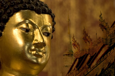 ordain: Show only head and face Image of Buddha. The Golden Sculpture.on the temple wallis Gold painting and art of Pattern.