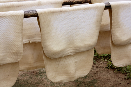 Make Rubber Sheet from Latex Latex from Rubber Tree Plantation Rubber in Thailand  photo