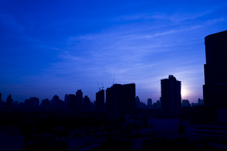 penumbra: Building in midtown of Bangkok city at twilight  Building are in indistinct and silhouette at dusk