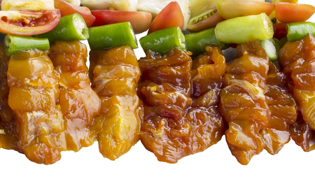 Raw Bar B Que,Pork Beef and Chicken with piece of pine apple,tomato and sweet pepper.isolate background.