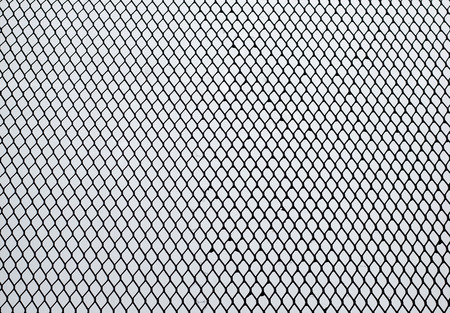 meshwork: Iron mesh fit in frame . Out of focus background are pattern of little meshsork.