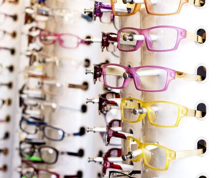 rimless: Eyeglasses hang on the wall.Intrend Fashion style in color and design.