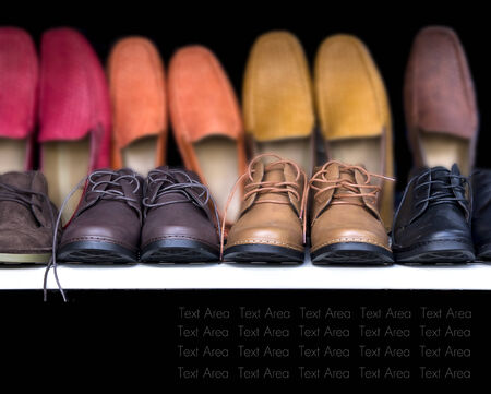 Men leather cut shoes lay on shelf. Display for shoes store.with text area. Standard-Bild