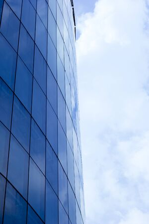 quietude: White Cloud  in calm day in winter. Reflection on glass  building.