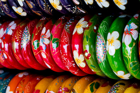 anklet: Many wood bracelet and flower painting,Display in souvenir shop,Close up shot. Stock Photo