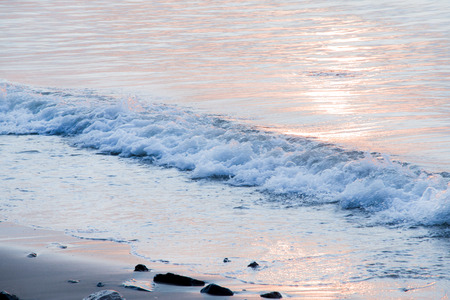 waver: Sea and wave, twist  on the seashore, Reflection in the sea with sunlight at early sunshine. Stock Photo