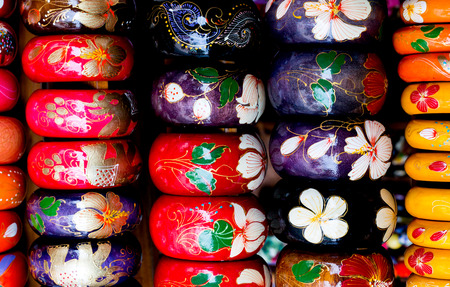 bangles hand: Many wood bracelet and flower painting,Display in souvenir shop,Close up shot. Stock Photo