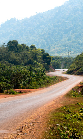 switchback: Switchback road in Laos,far form Luang Prabang to Vientiane,drive between the mountains and hill village.