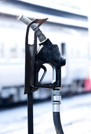 bogie: Fuel nozzle in diesel train platform,background is out of focus bogie.