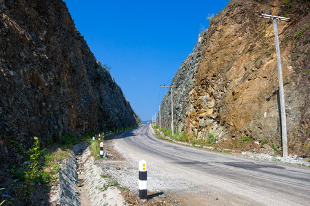mountain pass: Road between mountain pass at east-north of Laos,Blue sky background. Stock Photo