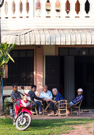 simple life: HONGSA XAIGNABOULI, LAOS - APRIL 12, 2015 : Cup of tea or coffee and talk something with friend in the morning.The simple  every day life of laos people in Hongsa town, Xaignabouli district. Editorial