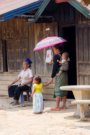 simple life: LUANG PRABANG, LAOS - APRIL 18, 2015: The simple  every day life of laos hill tribe in tribe village on the way from Luang Prabang to vientiane. Editorial