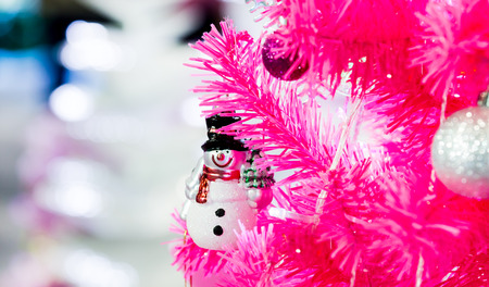 pink christmas: Snow man and pink christmas tree.for Merry Christmas and happy new Year card.