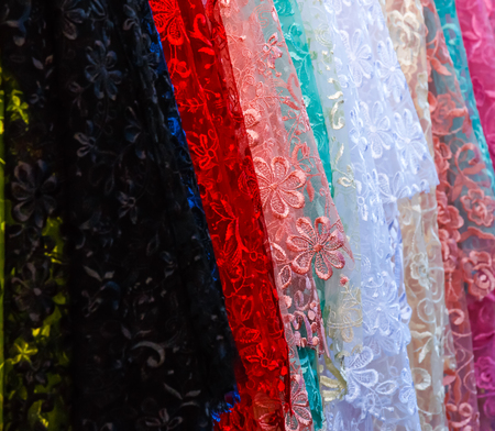 needle laces: Many color lace cloth display in fabric shop. Stock Photo