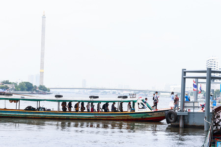 embark: Bangkok,Thailand - September 18, 2015 : The passengers disembark from ferry boat that cross Chao Phraya River.