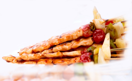 Bar B Que,Chicken with piece of pine apple,tomato and sweet pepper.White background and little shadow.
