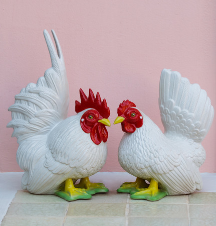 bantam hen: The white cock and white hen, Porcelain Bantam dolls for decoration interior.