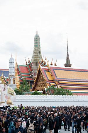 adulyadej: Bangkok, Thailand - Octoberr 22, 2016 : Thai people crowd in funeral of of His Majesty King Bhumibol Adulyadej around the grand royal palace.