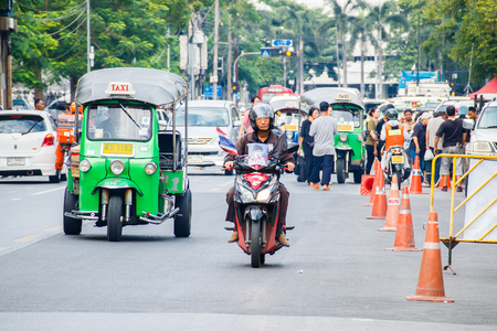 cheapness: BANGKOK, THAILAND - DECEMBER 2, 2016 : Every day life in Bangkok, People with low income like to use Tuk Tuk and Amazing that once should not be missed when tourists in Bangkok.. Editorial
