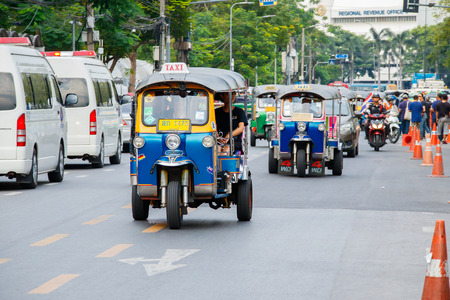 three wheeler: BANGKOK, THAILAND - DECEMBER 2, 2016 : Every day life in Bangkok, People with low income like to use Tuk Tuk and Amazing that once should not be missed when tourists in Bangkok.. Editorial