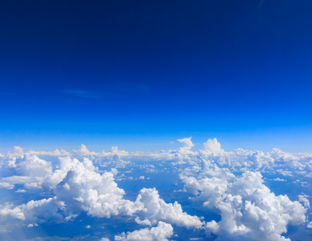 White cloud on blue sky. See through the plane window Stock Photo