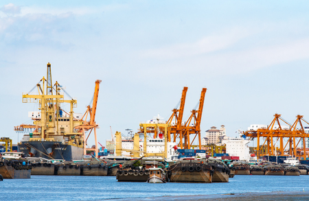 importance: BANGKOK, THAILAND - JUNE 23, 2015 : Cargo ship and tugboat with containers,importance business logistics, run from estuary along Chao Phraya river while water lack of.Problem from El Nino in Thailand.