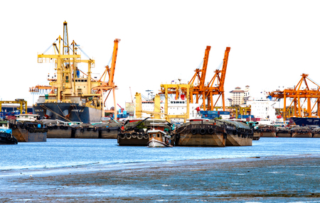 BANGKOK, THAILAND - JUNE 23, 2015 : Cargo ship and tugboat with containers,importance business logistics, run from estuary along Chao Phraya river while water lack of.Problem from El Nino in Thailand.