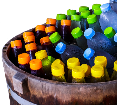 The beverage bottle in wood bucket, cooler with ice for thirsty.