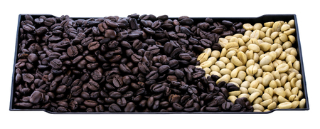 unroasted: Black roasted coffee beans and  White unrosted coffee beans. Top view and close up shot. Stock Photo