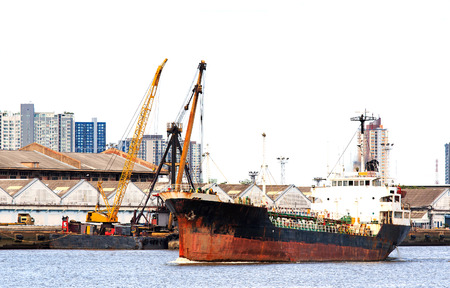 importance: Cargo Ship at Estuary.The Importance of business logistics.