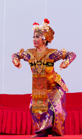 Ratchaburi, Thailand-April 13, 2016 : The girl in Bali culture dance. The action by eye, hand and move. Indonesia culture.