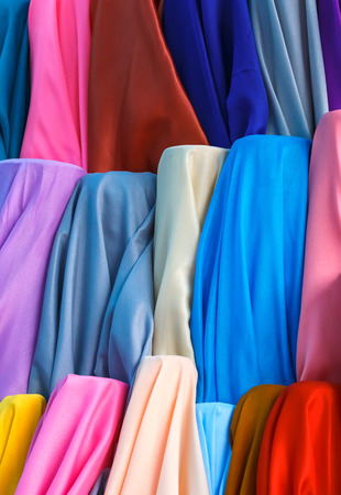 Many color fabric rolls in the fabric shop.