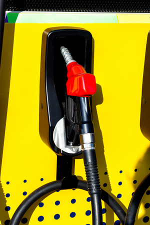 The fuel nozzle and difference color symbol of benzine, gasoline  and diesel.