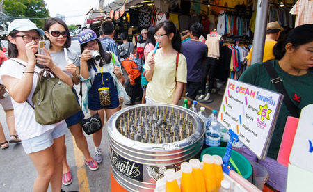 Bangkok,Thailand- September 1, 2016 : Chinese girls tourist enjoy with ice stick. Two years ago chinese tourist is the main income of the country, but Thailand government bans zero-dollar tour that reason illegally business tour.