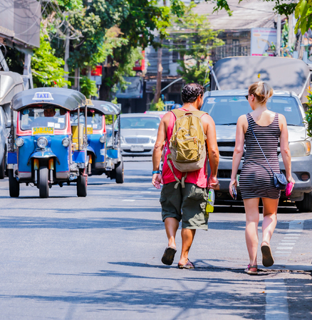 three wheeler: BANGKOK, THAILAND - MARCH 13, 2016 : Backpacker tourist at chinatown neighborhood in Bangkok Thailand, while Tourist is the main revenue of the country. Editorial