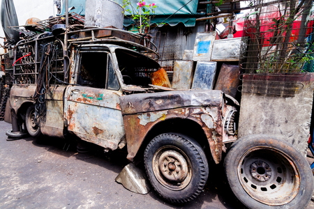 The junkyard from used spare part of machine for recycle. 写真素材
