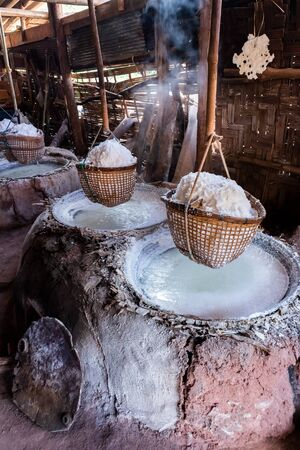 The table salt (rock salt) from the salt pits make by boiled to stream out the water.
